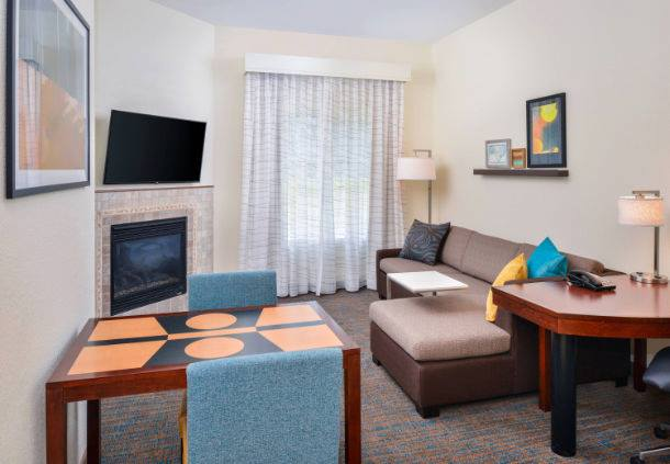 Living room and lounge area in an extended stay hotel